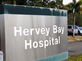 A WARDSMAN accused of choking a female co-worker with a plastic bag continues to work at the Hervey Bay Hospital pending the outcome of court proceedings.
