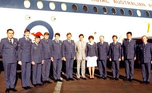 Ian Jacobsen in charge of VIP Royal Australian Airforce pictured with his team next to a dapper-looking Prince Charles.