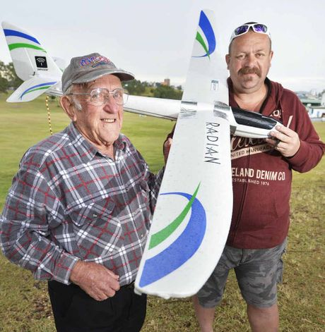 FLIGHT OF FANCY: Arthur Sollitt checks out the UFO with glider owner Schultzy, who flies the aircraft at night.