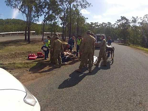 ARMY CRASH: Military personnel and emergency services tend to an 18-year-old army soldier after his vehicle rolled over at Kunwarara. Photo Contributed
