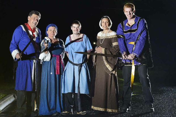 PREPARING FOR WAR: Rob and Kathy Lietzow, Paul Lauridsen, and Camila and Andrew Turner prepare for a medieval battle the likes of which they will never forget.
