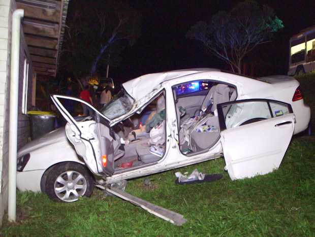Shocked residents are calling for action after a car ploughed down an embankment and narrowly missed crashing into a Urunga home on Friday night.