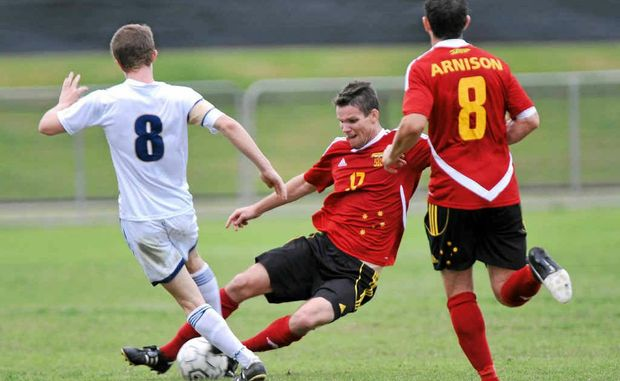 The Fire's Ryan Smith tackles CQ's Bradeon Crowley in the Fire's 9-0 victory over Central Queensland at Stockland Park.