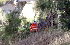 SES volunteers and police searching bushland adjacent to the Dee River in Mount Morgan for the missing couple. Photo: Chris Ison / The Morning Bulletin