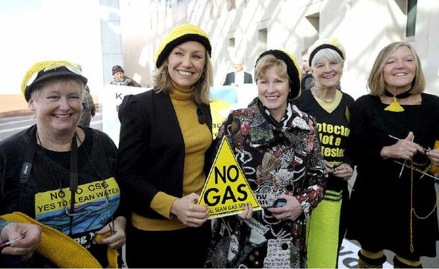 SIT-IN: Australian Greens Senators Larissa Waters and Christine Milne with members of Knitting Nannas Against Gas outside Parliament House.