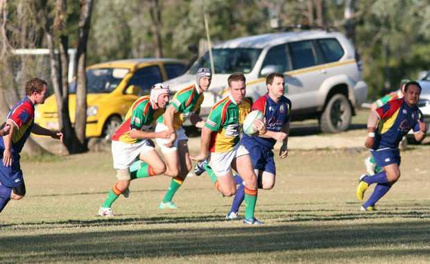 Drovers find a hole in Gladstone's defence during their home game in Moura last weekend. Photo Rebecca Hafner / Central Telegraph