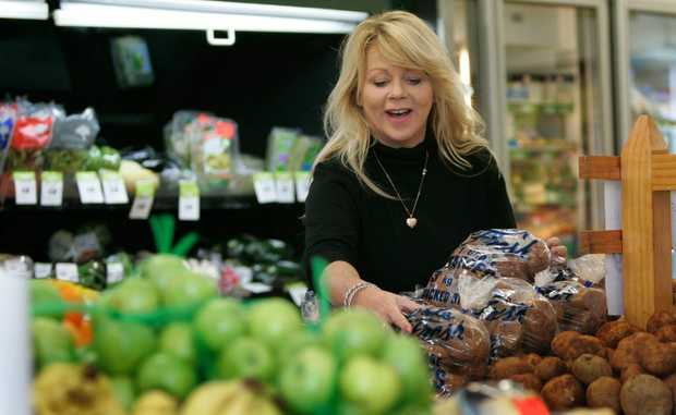 Co-owner of the Lakes Creek Supermarket, Sandi Ferguson in the fresh produce section. Photo: Chris Ison / The Morning Bulletin