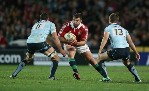 Alex Corbisiero of the Lions takes on Dave Dennis (L) and Rob Horne during the match between the NSW Waratahs and the British & Irish Lions at Allianz Stadium on June 15, 2013 in Sydney, Australia.