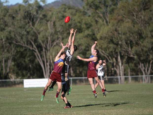 Glenmores James Murphy tries to punch the ball. Photo Allan Reinikka / The Morning Bulletin