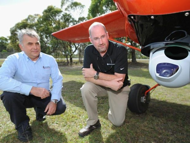 Seabird Aviation Australia managing director Peter Adams with UTC Aerospace Systems' Dean Johnston and the Cloud Cap camera fitted to the underneath a Seeker A3 plane.
