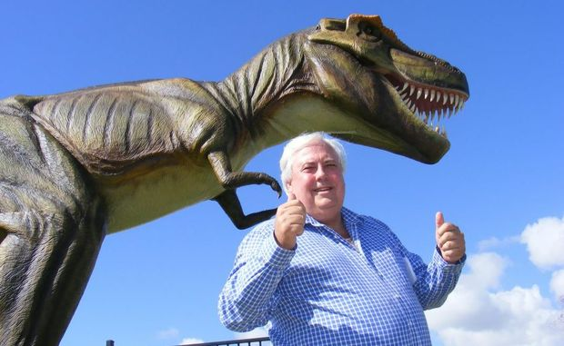 Clive Palmer with the dinosaur Jeff, during the 2012 PGA at Palmer Coolum Resort.