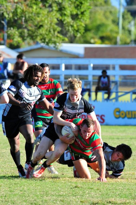 EASTS v HERVEY BAY: Easts' Kyle Laybutt tackles Hervey Bay's Tyrone Hopgod at Salter Oval. Photo: Max Fleet / NewsMail