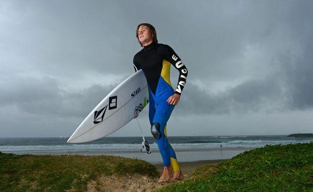 Quinn Bruce at Duranbah going for a surf.