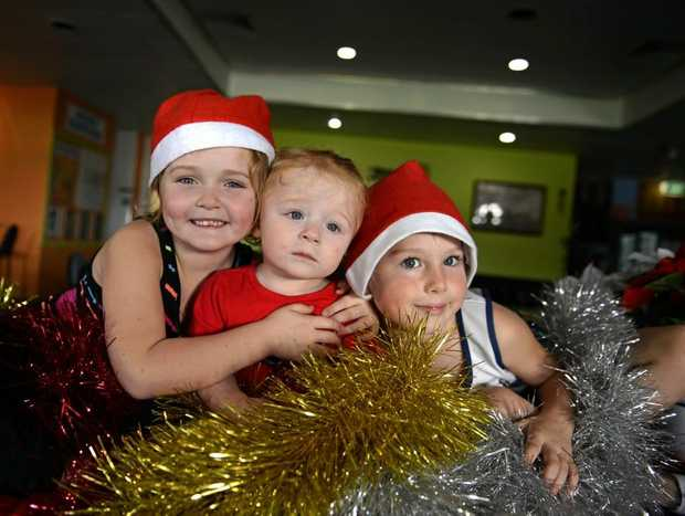 Mia Anderson, Rosa Philips and Cohan Warren at Kirra Sports Club for Xmas in July.