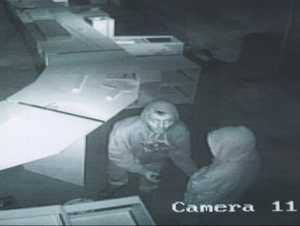 Pictures showing the two people robbing the new Government Department.