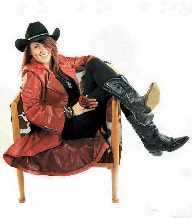 LITTLE BIT COUNTRY: Jayne Denham is a country chick with trucking at her heart.