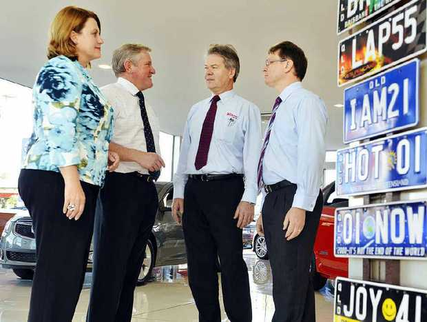 TOUGH TALK: Teresa Harding, LNP candidate for Blair, and Ian Macfarlane, Shadow Minister for Energy and Resources, talk with car dealers Greg Boettcher and James Sturges about the impact of changes to the fringe benefit tax on cars.