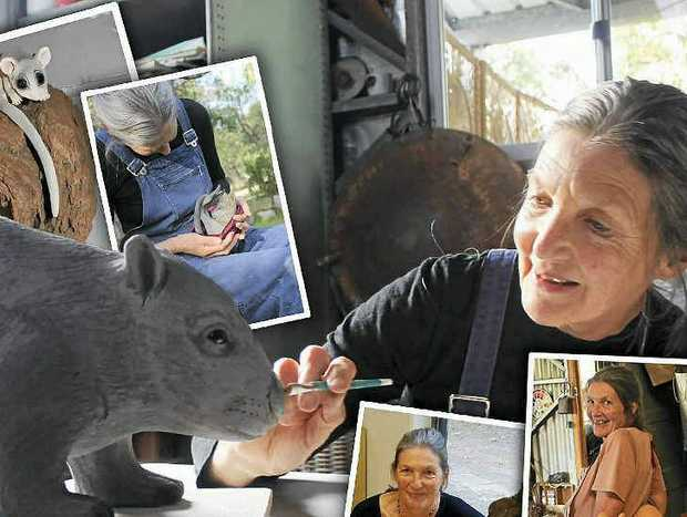 EYE FOR DETAIL: Artist Maggie Brockie adds the finishing touches to a common wombat she sculpted from clay. Below: Orphaned swamp wallaby joey Miss Molly became another subject.
