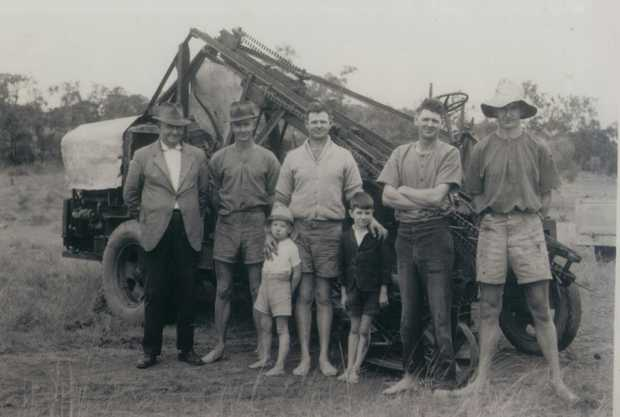 The Toft family in front of Joe's harvester in 1944, (back from left) Joseph Toft Snr, Col, Joe, Stan, Harold and youngsters Geoffrey and Cal Toft. Canegrowers' Bill Kerr has written many times that no single family made a bigger contribution to the development of mechanical cane harvesting in Australia than the Tofts.