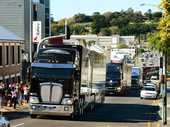 HIGH-powered machinery worth more than $100 million rumbled through Ipswich streets today as the V8 Supercar Transporter Parade came to town.