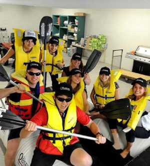 FUN BUNCH: The Observer crew preparing for the harbour festival raft race earlier this year.