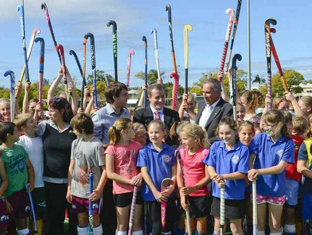YEAH!: Grafton Hockey Association president Bruce Carle, administrator Joel Ward with Minister for Sport and Recreation Graham Annesley and Clarence MP Chris Gulaptis and the players at an under-12 hockey workshop. Photo: Adam Hourigan