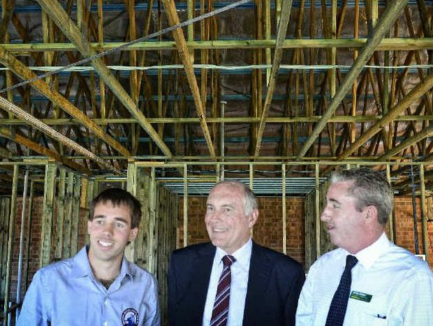 WE'LL HELP YOU OUT: Grafton Hockey sports administrator Joel Ward with National Party leader Warren Truss and candidate for Page Kevin Hogan announcing their support for extra funding to Grafton Hockey. Photo: Adam Hourigan