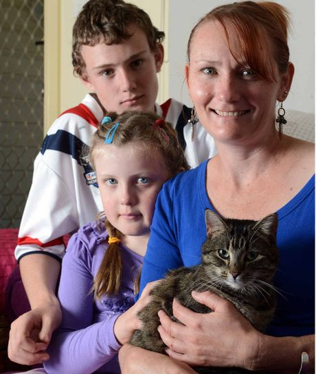 "REUNITED: Tammy Allen with her children, Luke, 12, and Jess, 8, of South Lismore reunited with their cat ""Miffy"" after it went missing two years ago."