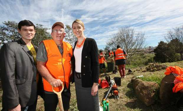 David Curtin, Wayne Williams and Joanna Dunn in land behind Mt Ommaney Centre where volunteers are helping to clean up. Photo Inga Williams / The Satellite