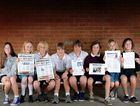 BUDDING EDITORS: Year Seven students from Byron Bay High School proudly display their mock-up newspaper front page history projects.