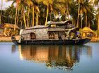 TAKE me to Kerala in enchanting India and let me explore the tranquil backwaters in a slow moving a wooden houseboat.
