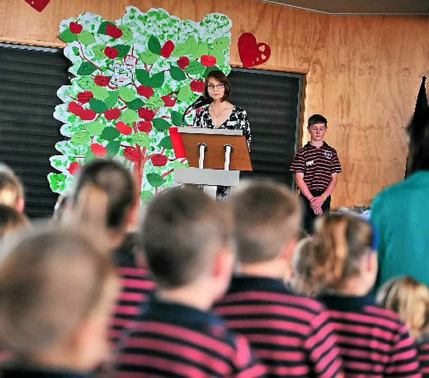 FAREWELL: Staff and students from St John Catholic Primary School held a memorial mass for the late principal Paul Daglish. Mrs Donna Masson is pictured addressing the mass.