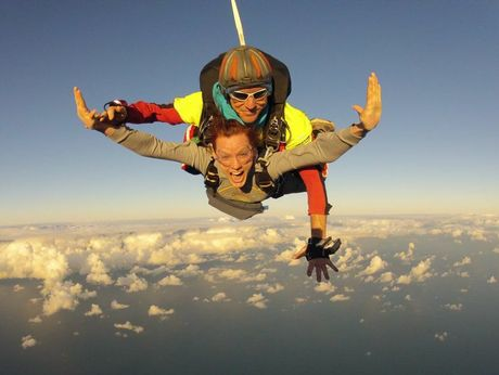 Laura Clark and Joe Ryan skydiving towards a surprise marriage proposal.