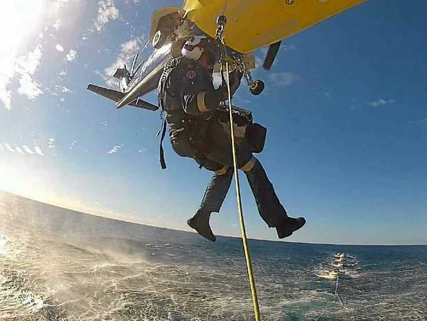The RACQ Capricorn Helicopter and Rescue team performs a sea rescue, similar to that of Wayne Sorensen's, 110 nautical miles off the coast.