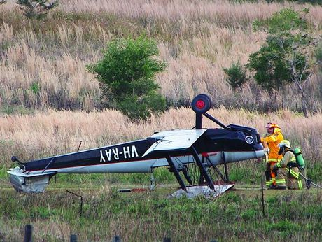 Emergency services respond to the aircraft rollover north of Coffs Harbour.
