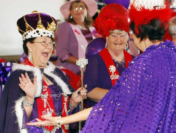 SPECIAL MOMENT: Queen Lynette Hoskins-Meech of Classy Ladies with Queen Dee Jen of Bubbles and Butterflies at the Red Hat Society coronation of Lynette Hoskins-Meech at Redbank Tavern.