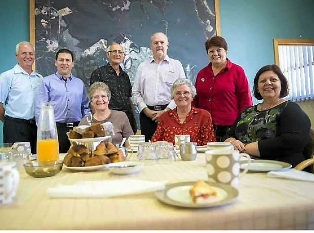 Col Chapman, Matt Burnett, Sister Margret Dixon, Ren Lanson, Rick Hanson, Sister Beryl Amedee, Maxine Brushe and Mayor Gail Sellers enjoy a morning tea to celebrate Sister Beryl Amedee's move to Melbourne after years of service to Gladstone.
