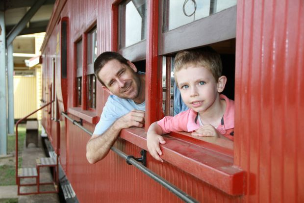 ALL ABOARD: Andrew and Jack Bauer experience the old carriages at the Railway Museum re-opening. Photo: Paul Donaldson / NewsMail