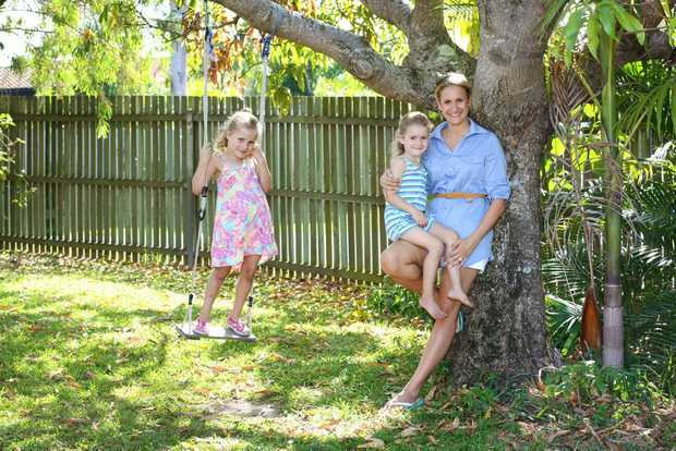 Image for sale: Maroochydore's Jodi Theisen with her daughters Gabriella, 6, (left) and Michaela, 4. New research shows that too much stimulus is not good for kids and Jodi agrees, she is happy to let her girls just be kids and have plenty of play time. Photo: Brett Wortman / Sunshine Coast Daily