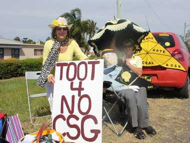 Knitting Nannas Anne Thompson and Debbie Harris with a cutout of Thomas George outside Metgasco's Casino office.