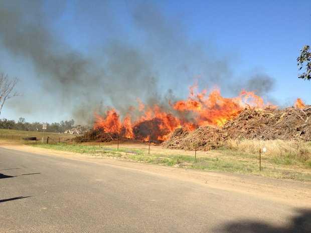 TIP FIRE: The blaze burning earlier today at the Nanango dump.