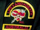 Bikies and librarian fined for wearing gang colours in pub