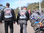 A FORMER Rebels bikie member says the trial of the Yandina Seven should be aborted now that the bikie laws under which the men were charged are under review.