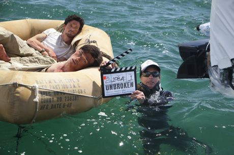 Actors Finn Wittrock and Jack O'Connell in Moreton Bay during the filming of Unbroken.