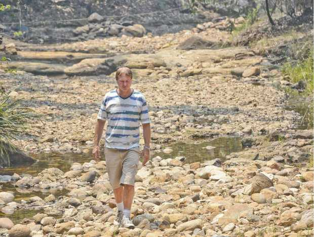 NO TRICKLE DOWN EFFECT: Manager of the Nymboida Canoe Centre Rob Delderfield walks along the dry upstream section of Goolang Creek.