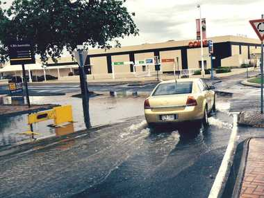 Water over road near City Centre Plaza around 4pm on November 17. Photo Frazer Pearce / The Morning Bulletin