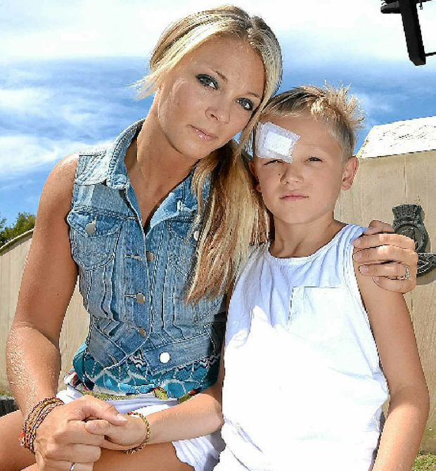 SORE AND SORRY: Seven-year-old Dre Conquest with his mother Elise at the HMAS Brisbane memorial lookout.