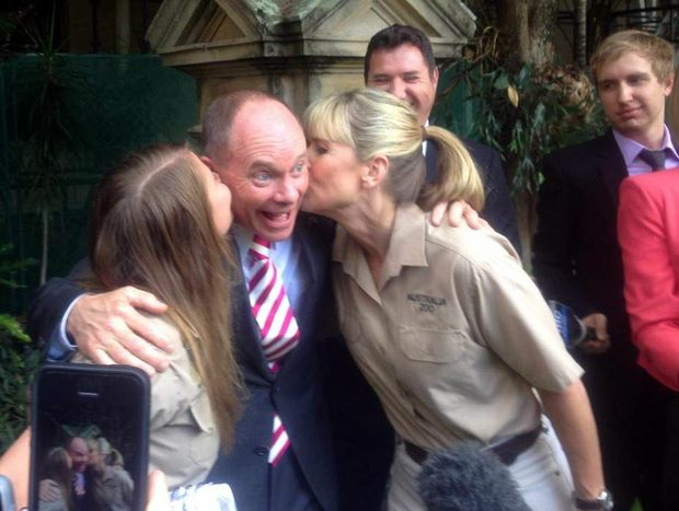 Premier Campbell Newman gets a kiss from Bindi and Terri Irwin after announcing that Steve Irwin Wildlife Reserve on Cape York will be forever protected.