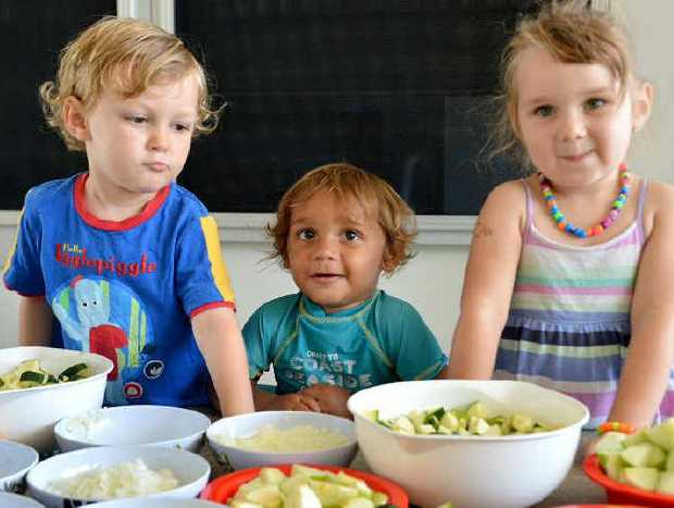 Jearvis Graham, Leelin Bell and Layla Mackey can't wait for the delicious chicken curry being prepared and cooked for lunch.