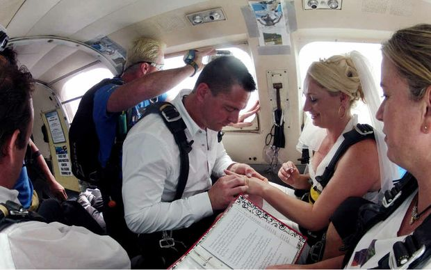 EVERLASTING: Janelle Ragen and Brendan Ward tie the knot at 14,000 feet above Ballina.